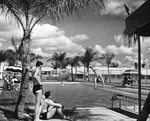 Students relax by the pool, Carlstrom Field by Embry-Riddle Aeronautical University
