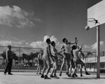 Cadets playing basketball by Embry-Riddle Aeronautical University